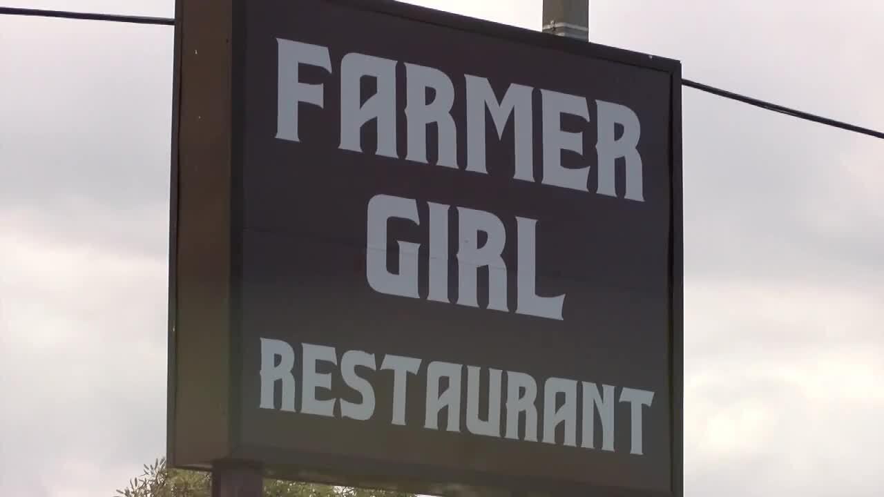 Farmer Girl Restaurant sign closeup