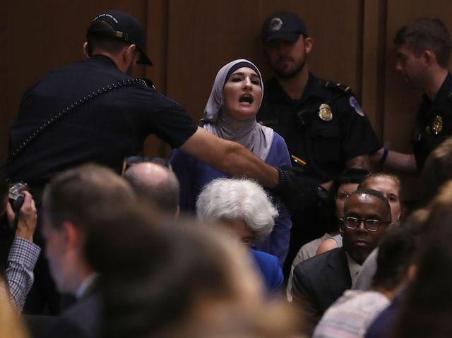 Photos: Protesters attend confirmation hearing for Supreme Court judge nominee Brett Kavanaugh