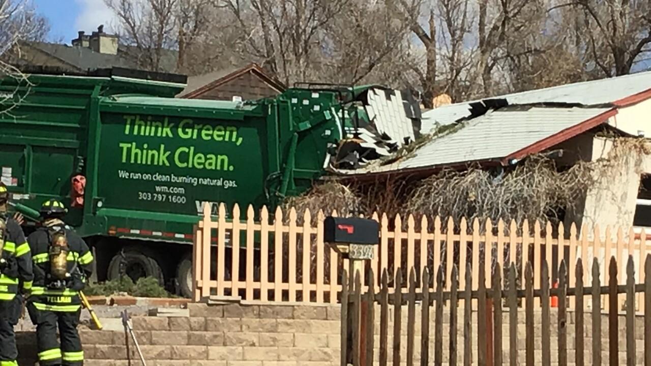 trash truck into home in Denver_Feb 24 2021
