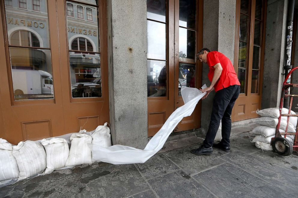 An employee places sandbags in front of a business in the French Quarter as Tropical Storm Barry approaches land in New Orleans, Louisiana, July 12, 2019 (Jonathan Bachman/Reuters)