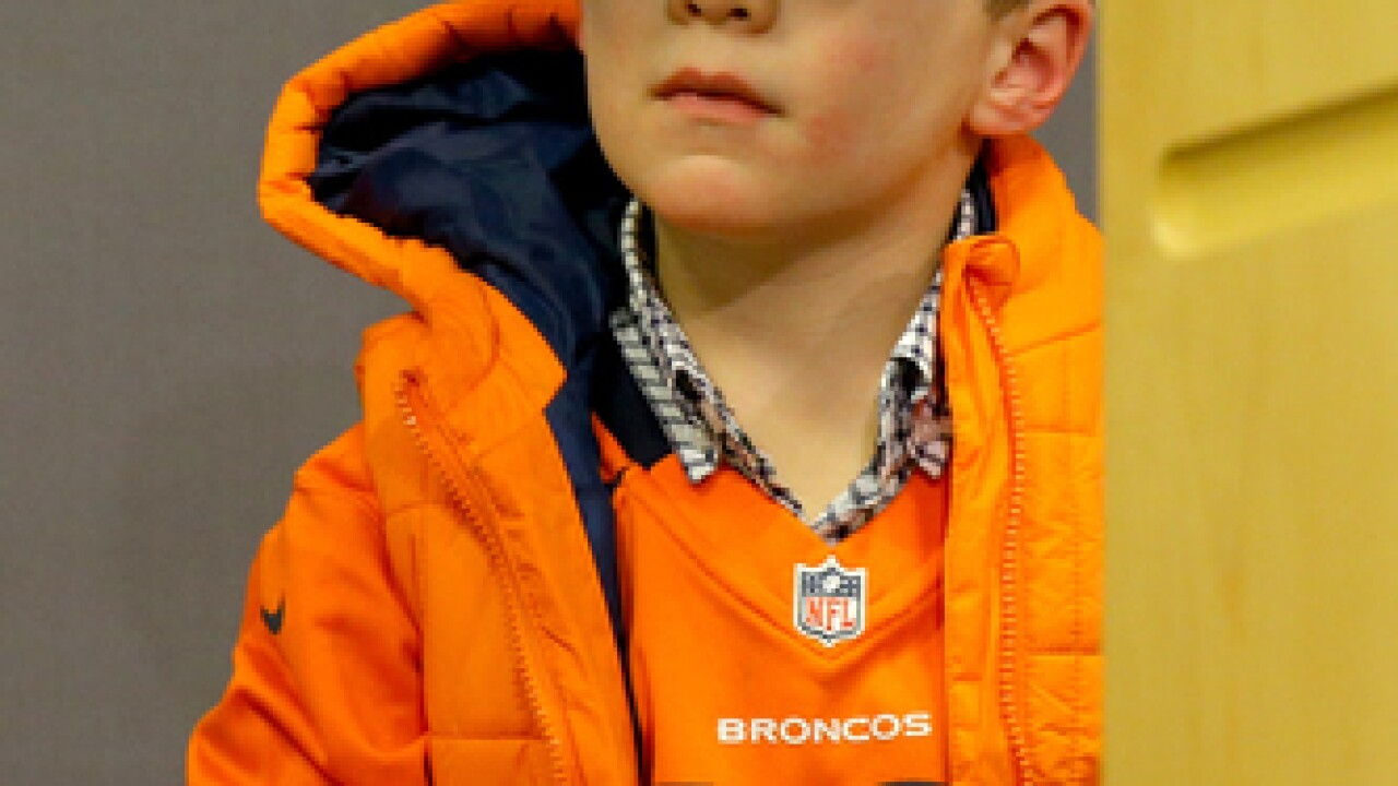Peyton's son pops out at press conference