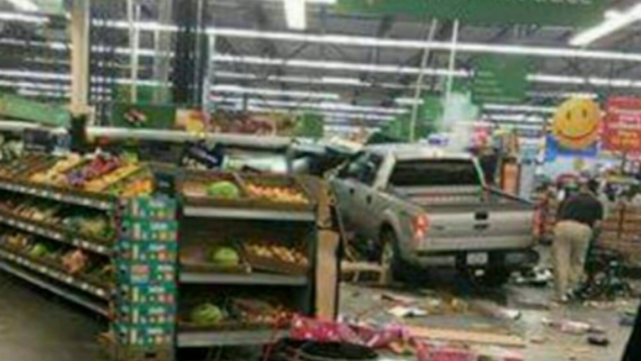 Three dead after truck crashes through doors of Iowa Wal-Mart
