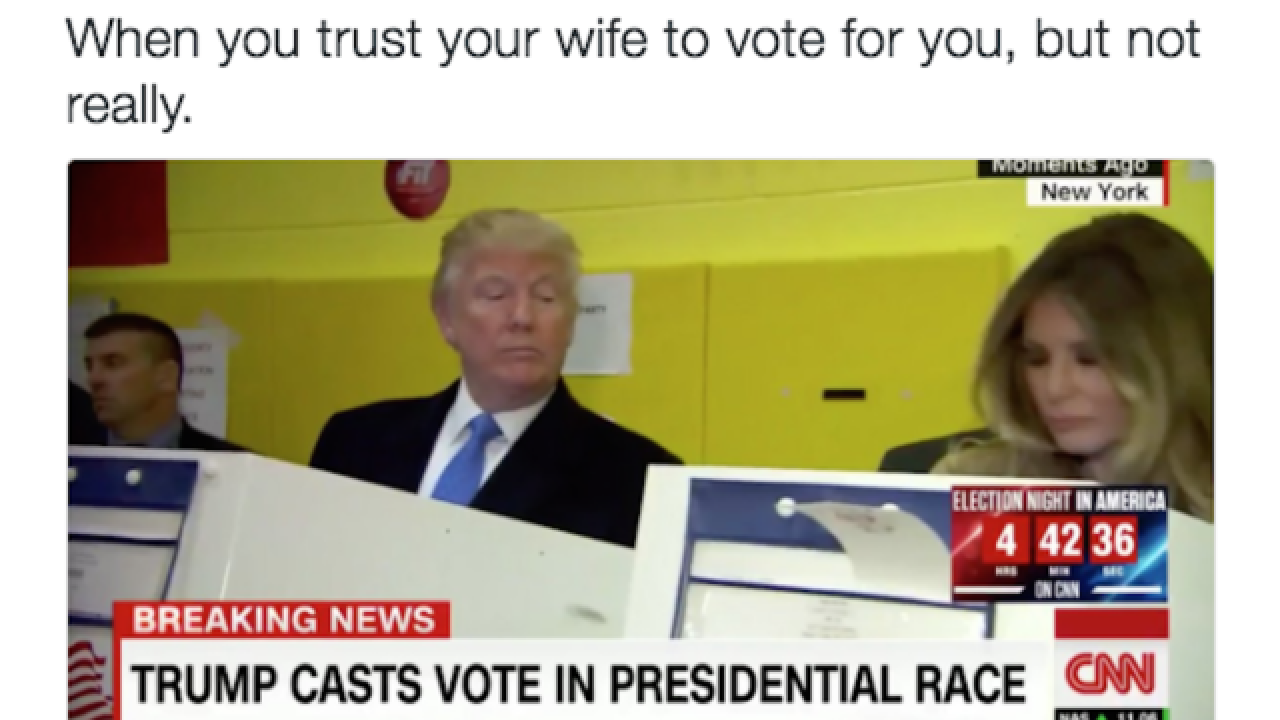 Donald Trump peers over wife Melania's shoulder as she votes, photo goes viral