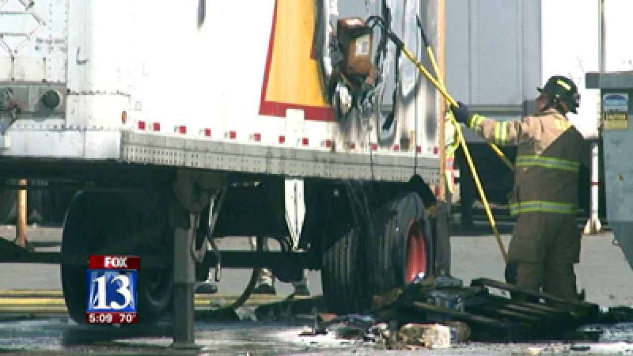 Crews douse chemical-caused semi fire in SLC