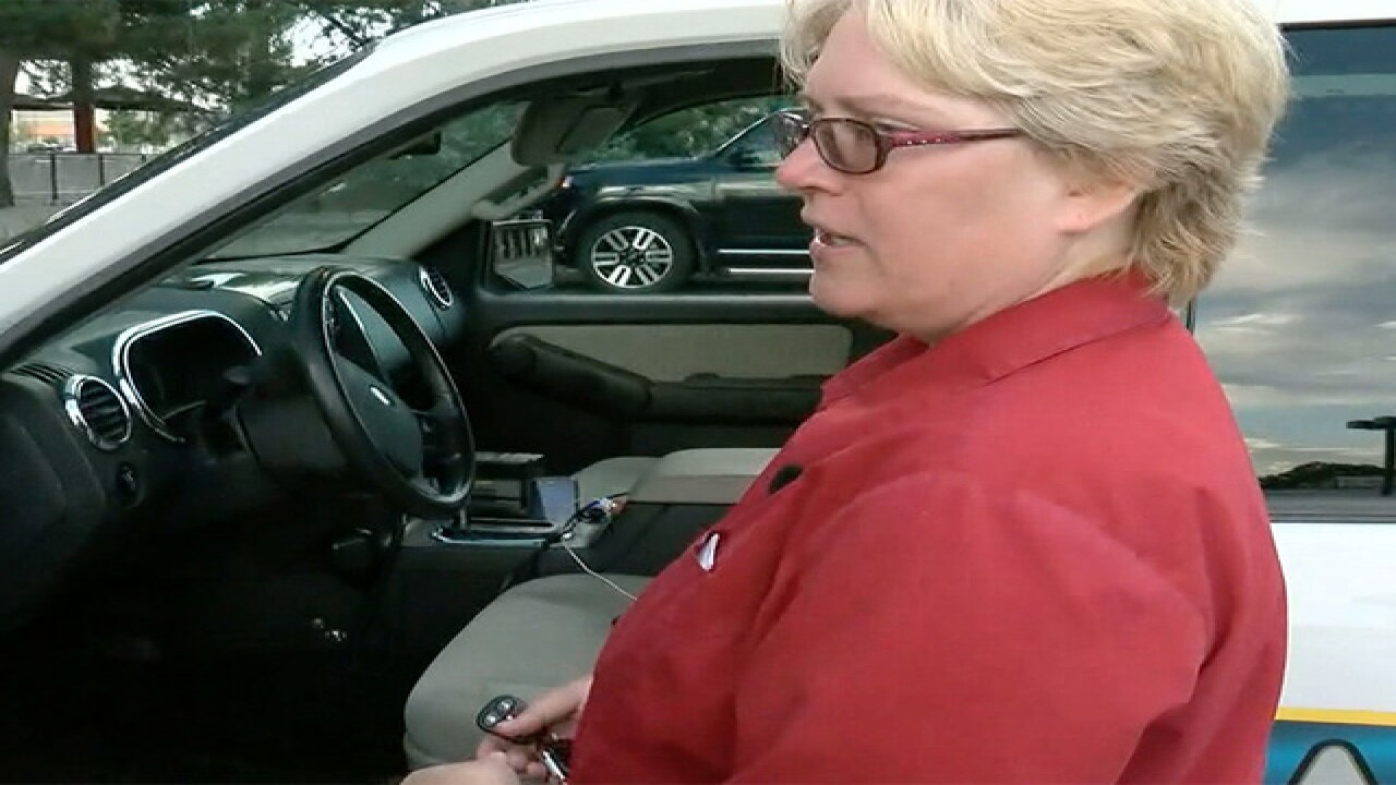 Aurora woman carjacked at gunpoint shares story