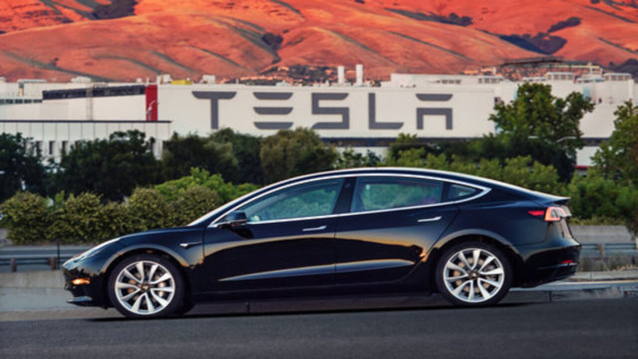 Tesla delivers first lower-cost Model 3 cars