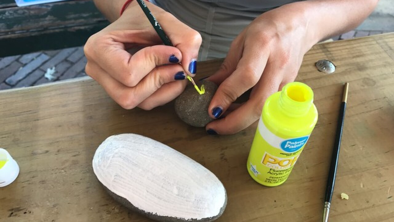 Painting rocks to spread kindness