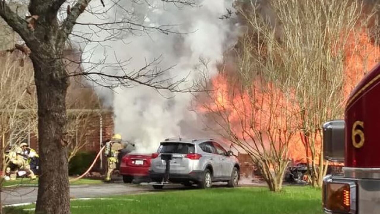 Firefighters, civilian injured after Suffolk garage fire extends to house