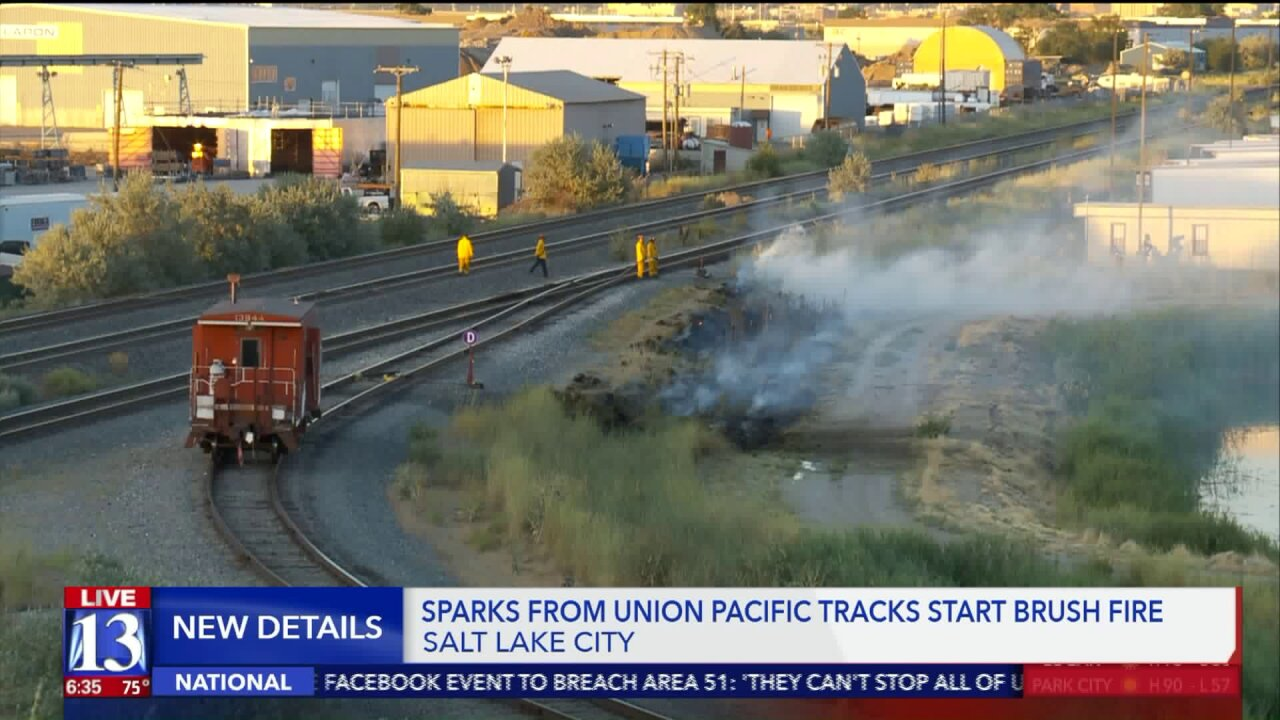 Firefighters warn of red flag conditions after passing train sparks brush fire in Salt Lake City