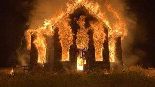 Old schoolhouse on fire