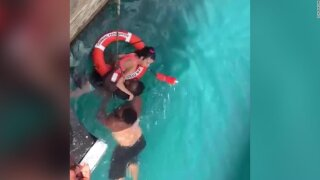 Two men rescued a wheelchair-bound woman who fell off a dock into the ocean