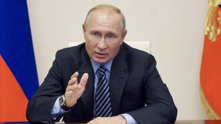 FILE In this file photo taken on Thursday, July 9, 2020, Russian President Vladimir Putin gestures during a video conference meeting at the Novo-Ogaryovo residence outside Moscow in Moscow, Russia. Putin says that a coronavirus vaccine developed in the country has been registered for use and one of his daughters has already been inoculated. Speaking at a government meeting Tuesday, Aug. 11, 2020, Putin said that the vaccine has proven efficient during tests, offering a lasting immunity from the coronavirus. (Alexei Druzhinin, Sputnik, Kremlin Pool Photo via AP, File)
