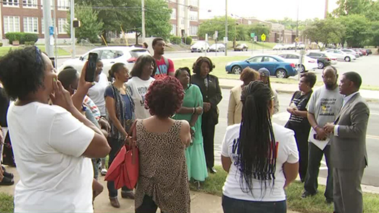 Neighbors Discuss Recent Officer-Involved Shooting At Town Hall