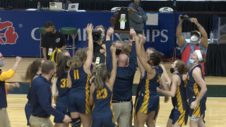 Casey Glass hoists trophy after Hudsonville state title