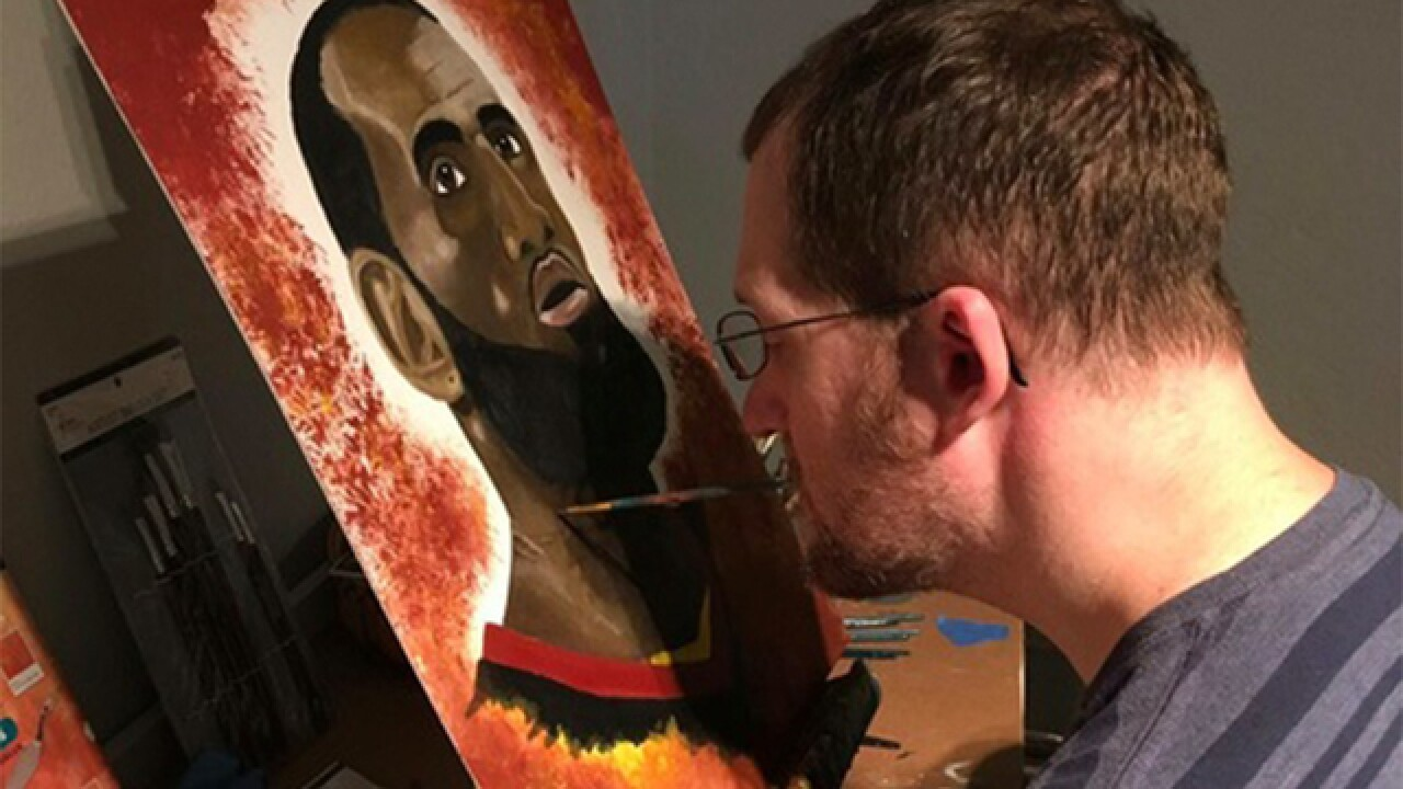 Colorado man, undeterred by rare disease, uses mouth to paint