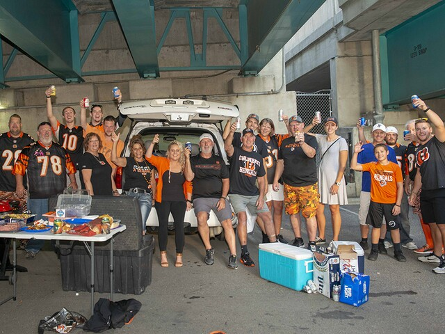 Bengals fans celebrate home opener with drinks, wings and bright orange mohawks