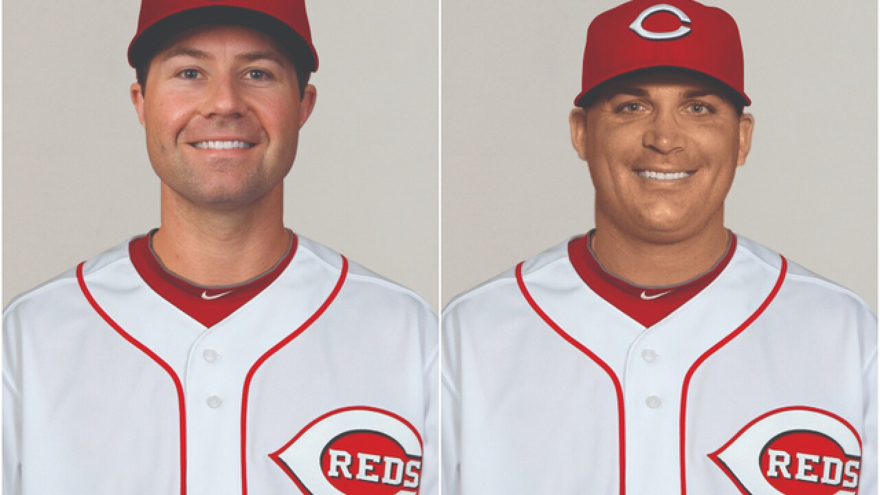 Reds add two more coaches to staff