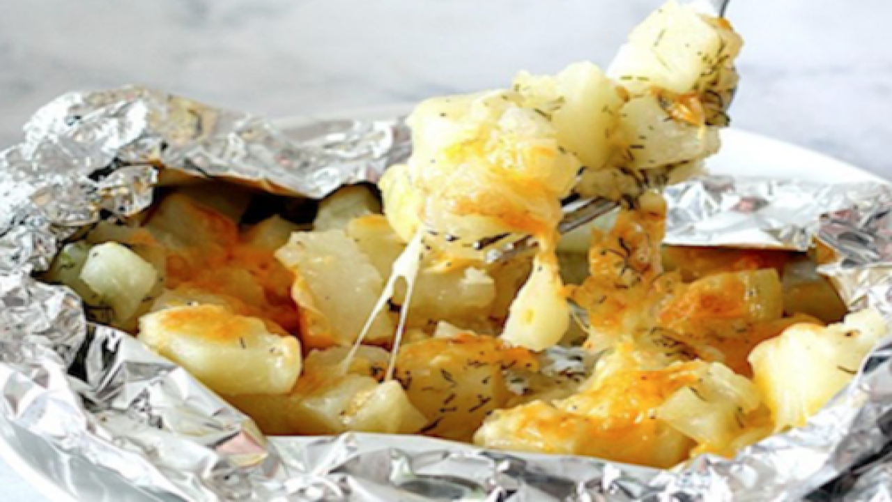 These Cheesy Potato Foil Packs Are The Perfect Dish For When You're Sitting Around The Campfire