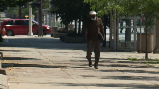 A man seen with a mask walking through downtown Cleveland.