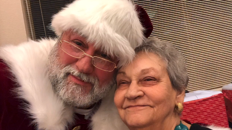 Bob Fuchs said his mom Kathleen is a big reason for why he loves Christmas so much and has dressed up as Santa the past few years.