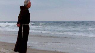 Father JUDGE on beach