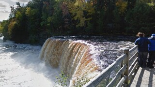 Water rushing over Tahquamenon Falls at 10,000 gallons per second