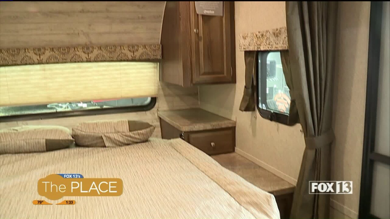 The travel trailer frees up valuable space with a Murphy bed