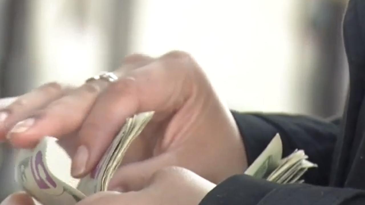 U.S. widow counting money