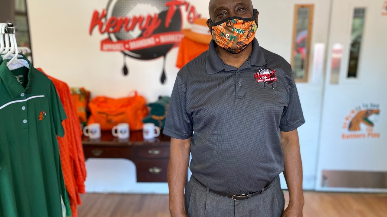 Ken Thompson stands in his store Kenny T's