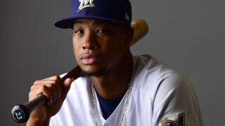 Brewers outfielder Keon Broxton leaves game after taking pitch to face