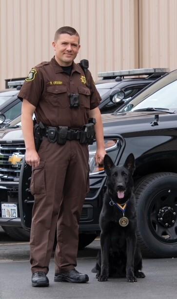 Deputy Crosby and K9 Blek with Medal.jpg