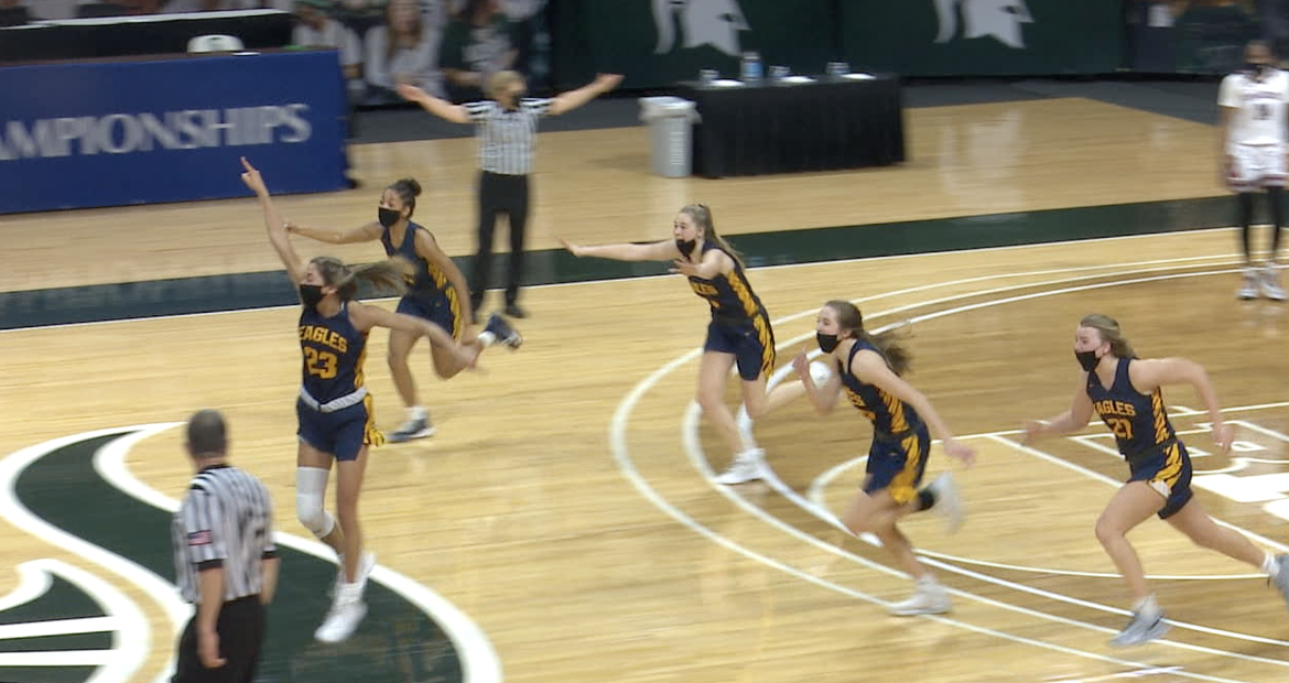 Hudsonville celebrates at the buzzer