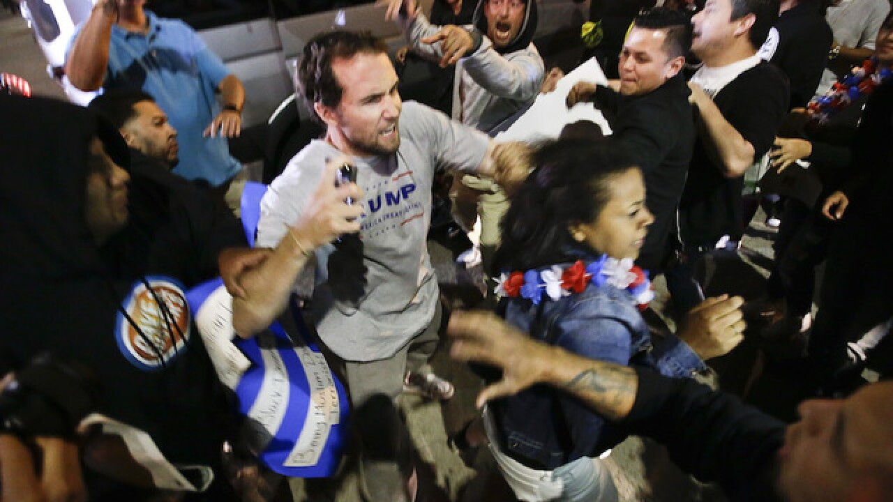 Protesters clash outside Trump rally in Calif.