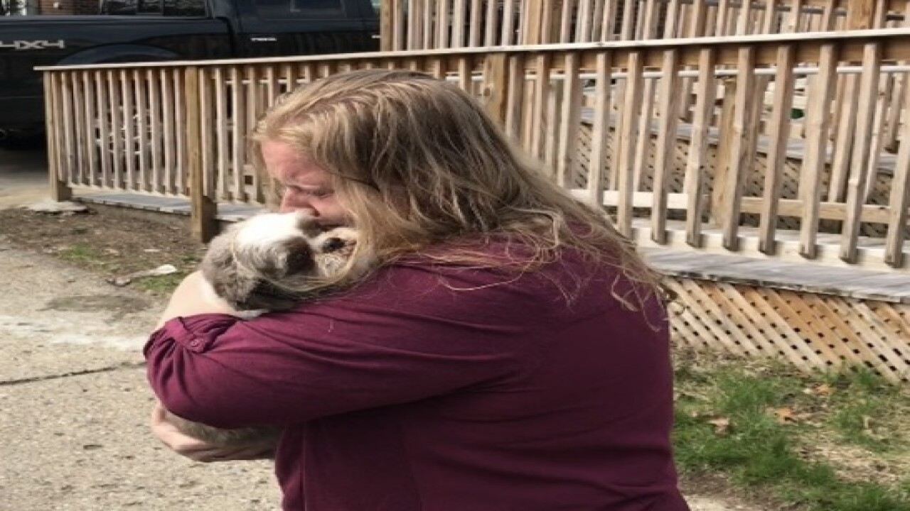 Woman reunited with dog stolen in front of store