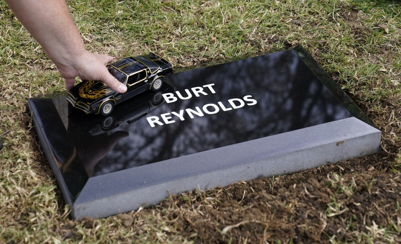 miniature Trans Am placed on Burt Reynolds memorial headstone at Hollywood Forever Cemetery, Feb. 11, 2021
