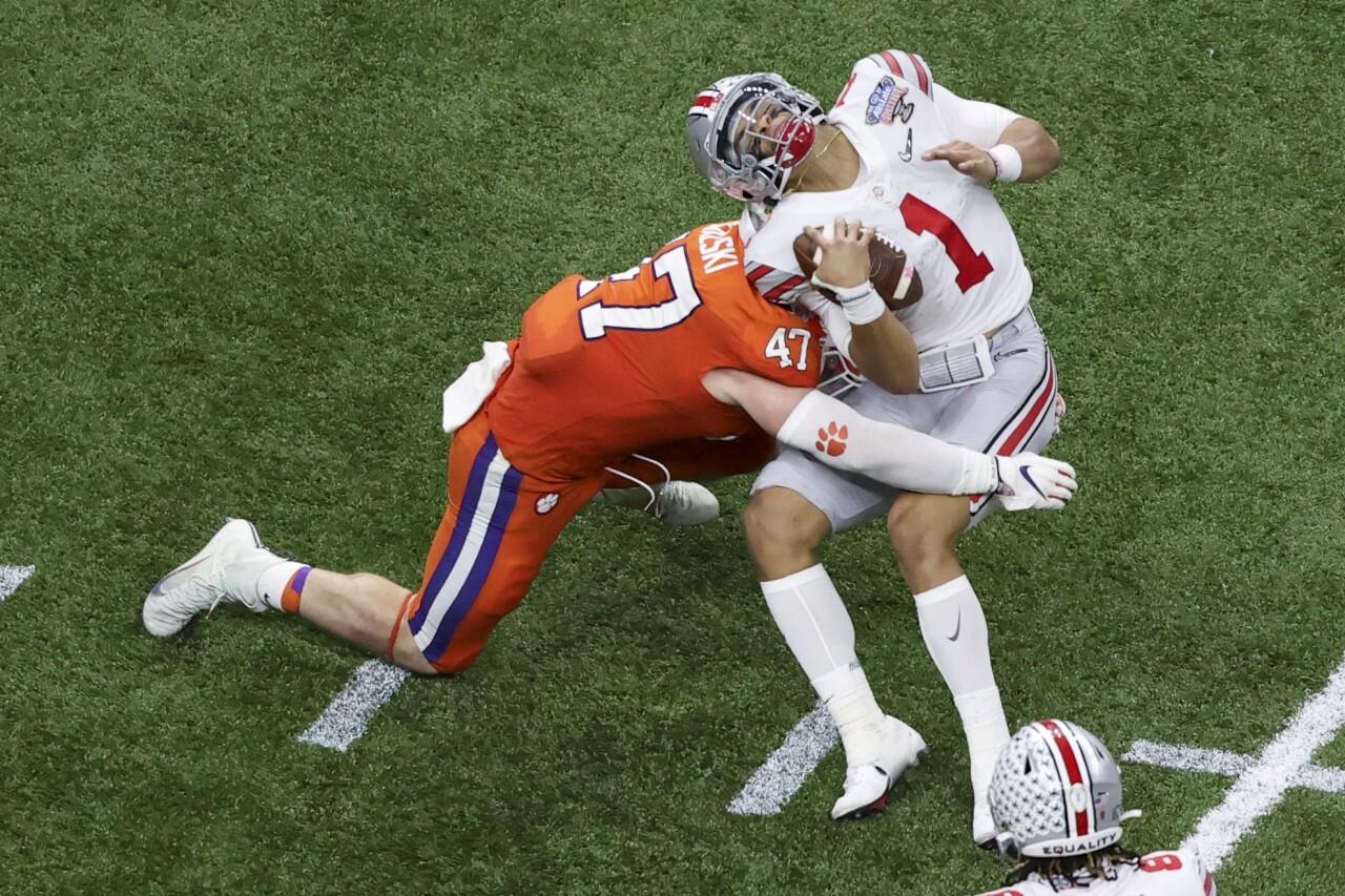 Clemson Tigers linebacker James Skalski hits Ohio State Buckeyes QB Justin Fields in College Football Playoff at Sugar Bowl