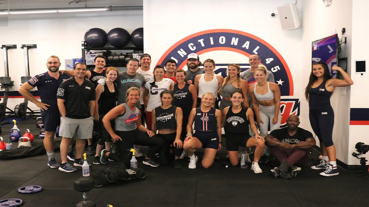 Mark Wahlberg poses for photo with staff at F45 Training in Jupiter