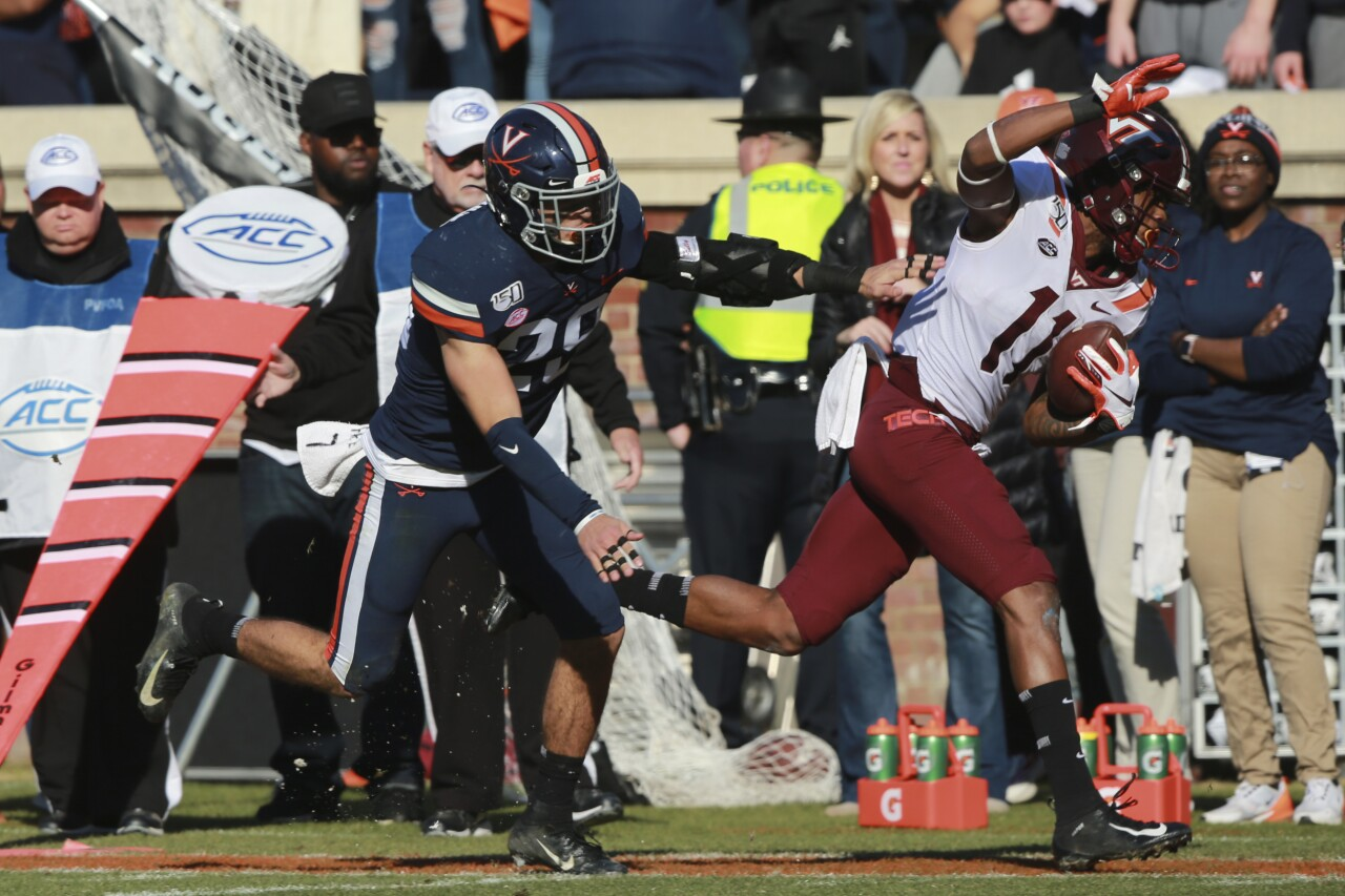 Virginia Cavaliers safety Joey Blount shoves Virginia Tech Hokies receiver Tre Turner out of bounds in 2019