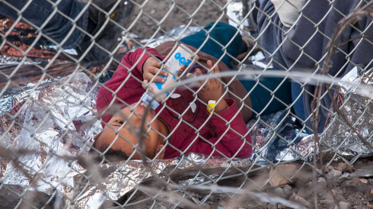 Advocate: Toddlers got bruises sleeping on gravel when US detained them under a border bridge