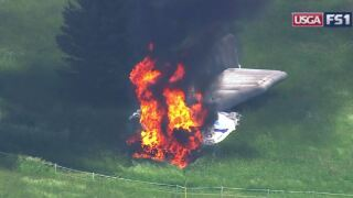 Raw Video: Blimp catches fire, falls out of sky at US Open