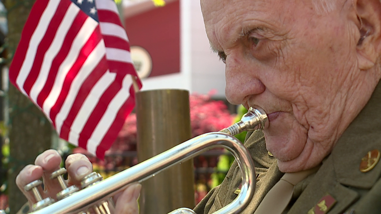 Stewart Boone playing his trumpet.png