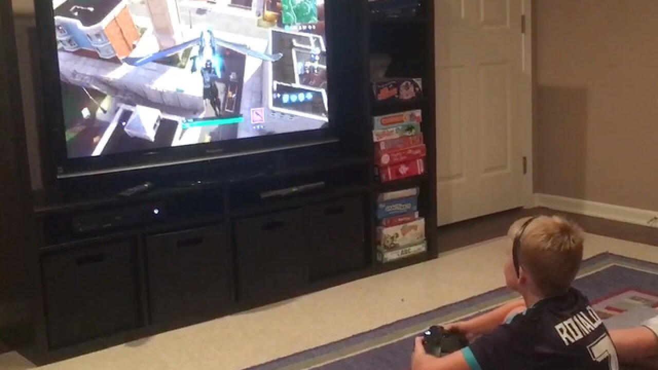 Backpacks replace controllers: Parents record Fortnite parody video