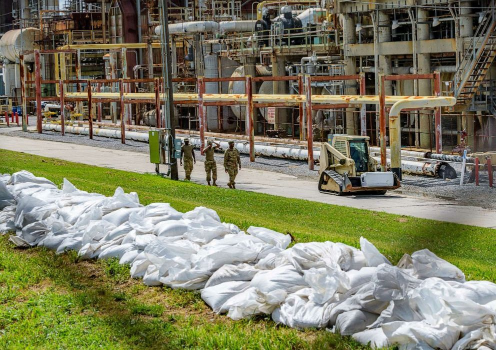 Soldiers with the U.S. Army National Guard work on adding sandbags to levees by the Chalmette Refining plant in Chalmette, La., July 11, 2019, ahead of Tropical Storm Barry (Matthew Hinton/AP).