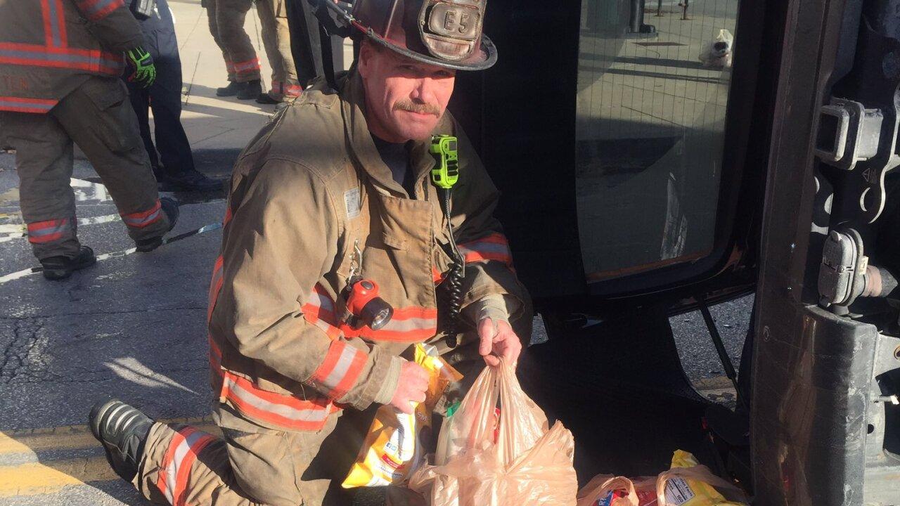 Cincinnati firefighters bring back groceries.jpg