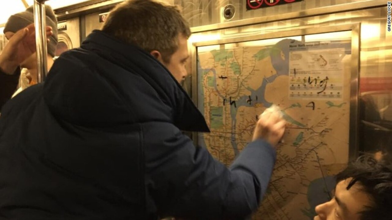 New Yorkers unite to scrub hateful graffiti from subway