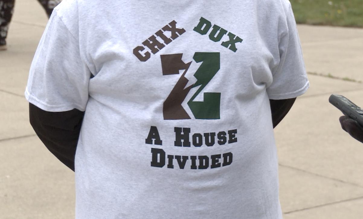 Jennifer Agar's shirt supporting both sons