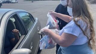 Volunteers deliver food to families in Cherry Creek School