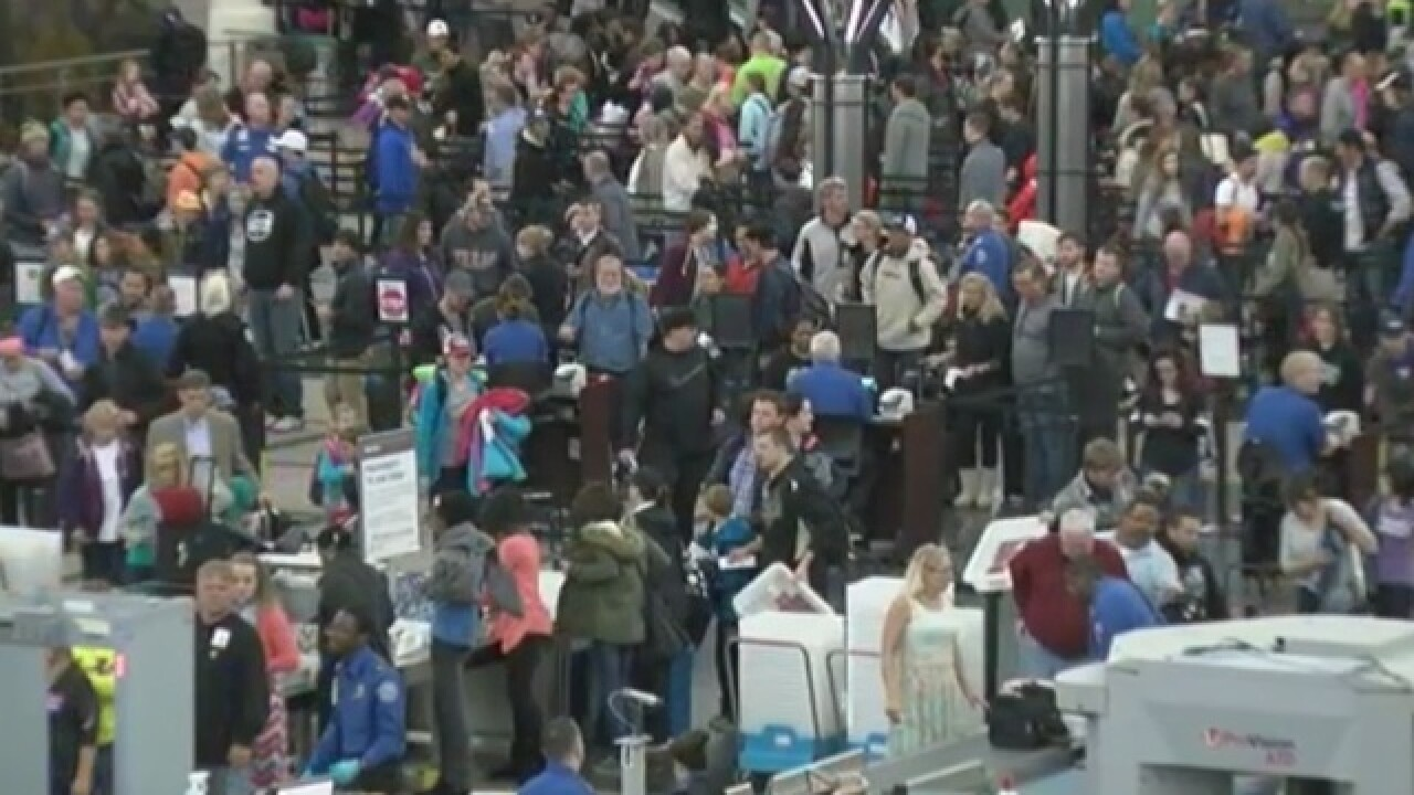 Travelers flood DIA day after blizzard