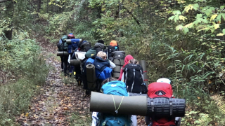 Students return from woods