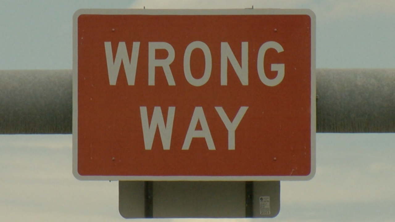 Wrong-way driving sign